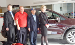 """Pictured with the 2018 Buick Encore SUV that will be leased to the winner of the Salem Regional Medical Center Foundation's Car Raffle Fundraiser are, from left, George Morris III, special events chair, SRMC Foundation; Mike Hudock, general manager, Stadium GM Superstore; """"Shorty"""" Navarro, owner, Stadium GM Superstore; and Amy Reed, SRMC director of development. (Submitted photo)"""