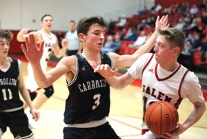 Salem's Seth Shivers drives against Carrollton's Adam Chaney during Friday's game at Salem.