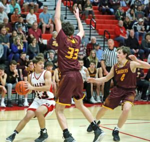 Salem's Zach Bezon tries to pass around South Range's Brady White (33) and Brennan Toy (4) during Tuesday's game at Salem