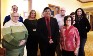 "Dr. Mike Sevilla visited Brookdale Salem and shared information regarding ""Heart Health as We Age"" to 30 residents and guests as part of the celebration for American Heart Month. Heart Healthy snacks were served following the talk. Pictured, from left, first row, Marsha Stoffer, Salem Sr. Housing; Sevilla, Family Practice Center of Salem; Debbie Leggett, sales and marketing manager at Brookdale; second row, Adam Roller, Myers Family Insurance; Lindsay Root, Community Home Health; Jeanette Farwell (partially obscured), St Paul's Catholic Church; Joe Nelson, First Light Home Care; Debbie Horvath, Southern Care Hospice;  and Jen Corvino, Community Hospice. (Submitted photo)"