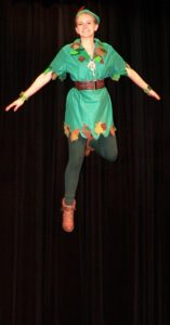 "Peter Pan (Sydney Marra) flies above the stage in preparation for United High School's presentation of ""Peter Pan."" The musical will be offered at 7 p.m. Friday and Saturday and 2:30 p.m. Sunday in the high school auditorium. Tickets can be purchased in advance at www.unitedboxoffice.org. (Salem News photo by Kevin Howell)"