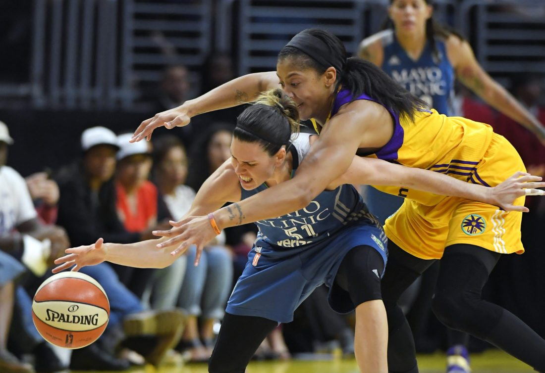 In this Sunday, Oct. 16, 2016, file photo, Los Angeles Sparks forward Candace Parker, right, reaches in on Minnesota Lynx guard Anna Cruz during the second half in Game 4 of the WNBA Finals in Los Angeles. A hotly contested WNBA Finals gets what it deserves, a deciding Game 5. The Lynx are going for their fourth championship and the Sparks need one more win to break up the dynasty.