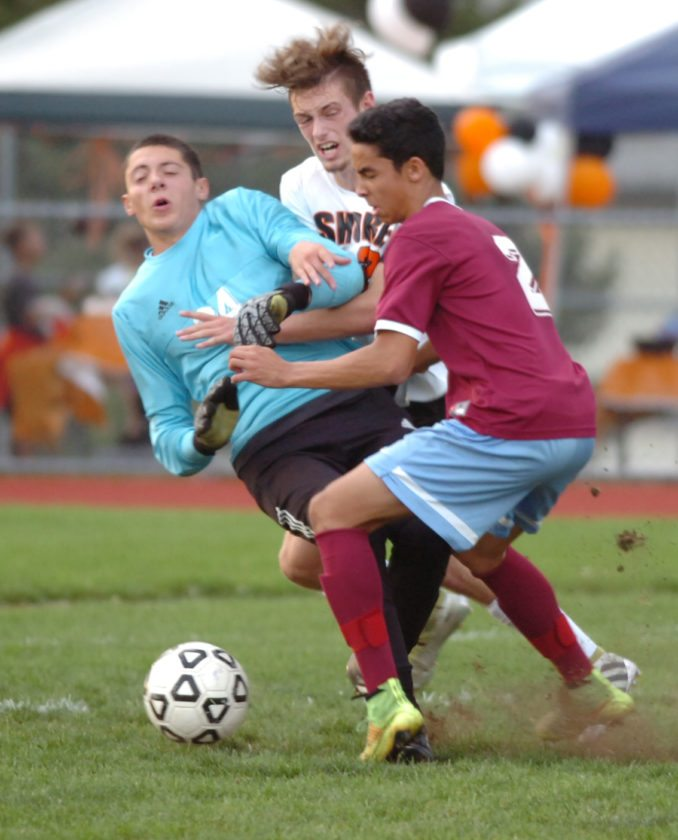 Loyalsock goalkeeper Matt Loeh, left, collides with teammate Ilan Quintana and Jersey Shore's Connor Anderson during the first half at Jersey Shore on Thursday afternoon. MARK NANCE/Sun-Gazette