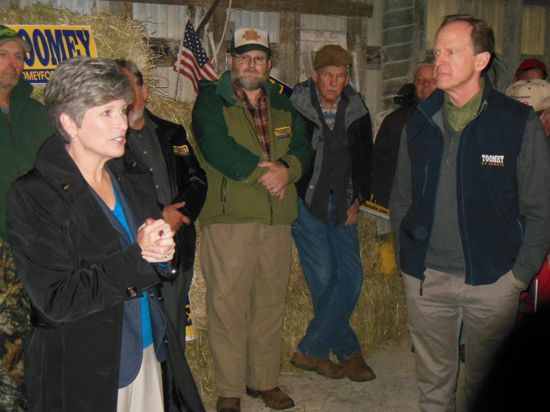 MARK MARONEY/Sun-Gazette U.S. Sens. Pat Toomey, R-Zionsville, left, and Joni Ernst, R-Iowa. stopped by the Waltz Dairy Farm near Jersey Shore Thursday during a campaign stop.