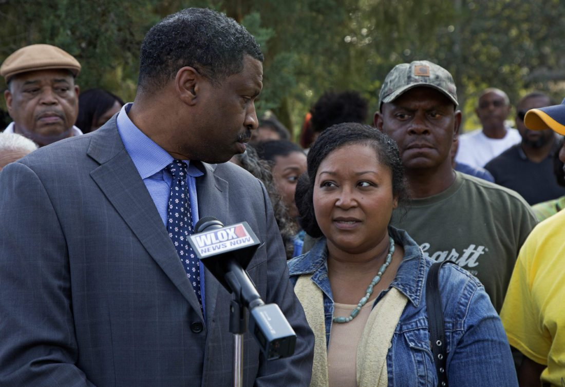 ASSOCIATED PRESS Derrick Johnson, left, president of the Mississippi NAACP, left, talks to Stacey Payton, center, with Hollis Payton, behind her, parents of a high school student, in front of the Stone County Courthouse in Wiggins, Miss., on Monday. Johnson is demanding a federal investigation after the parents said four white students put a noose around their son's neck at school.