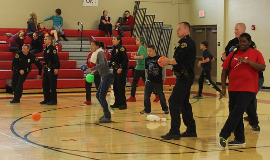 MEGAN E. BLOOM/ Sun-Gazette City police officers and middle school students play dodgeball at Williamsport Area Middle School on Friday, capping Red Ribbon Week with a Dodge Drugs Dodgeball event that encouraged student to be drug free.