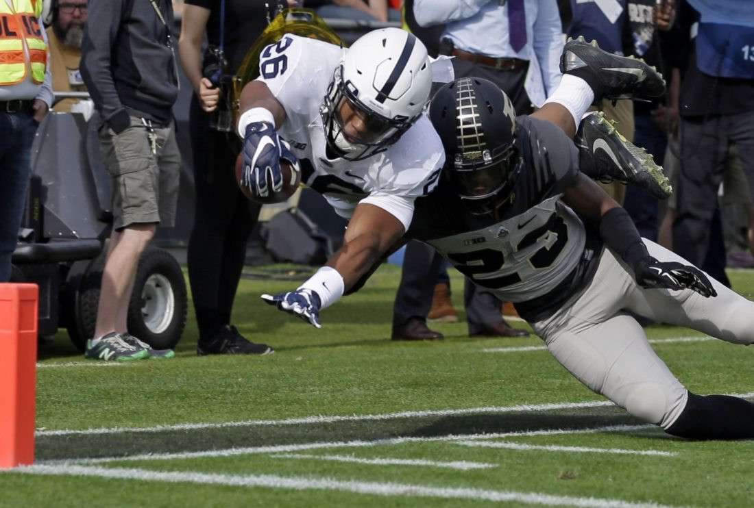 Penn State running back Saquon Barkley (26) dives short of the goal line as he's hit by Purdue cornerback Josh Hayes (23) during the first half Saturday at Purdue.