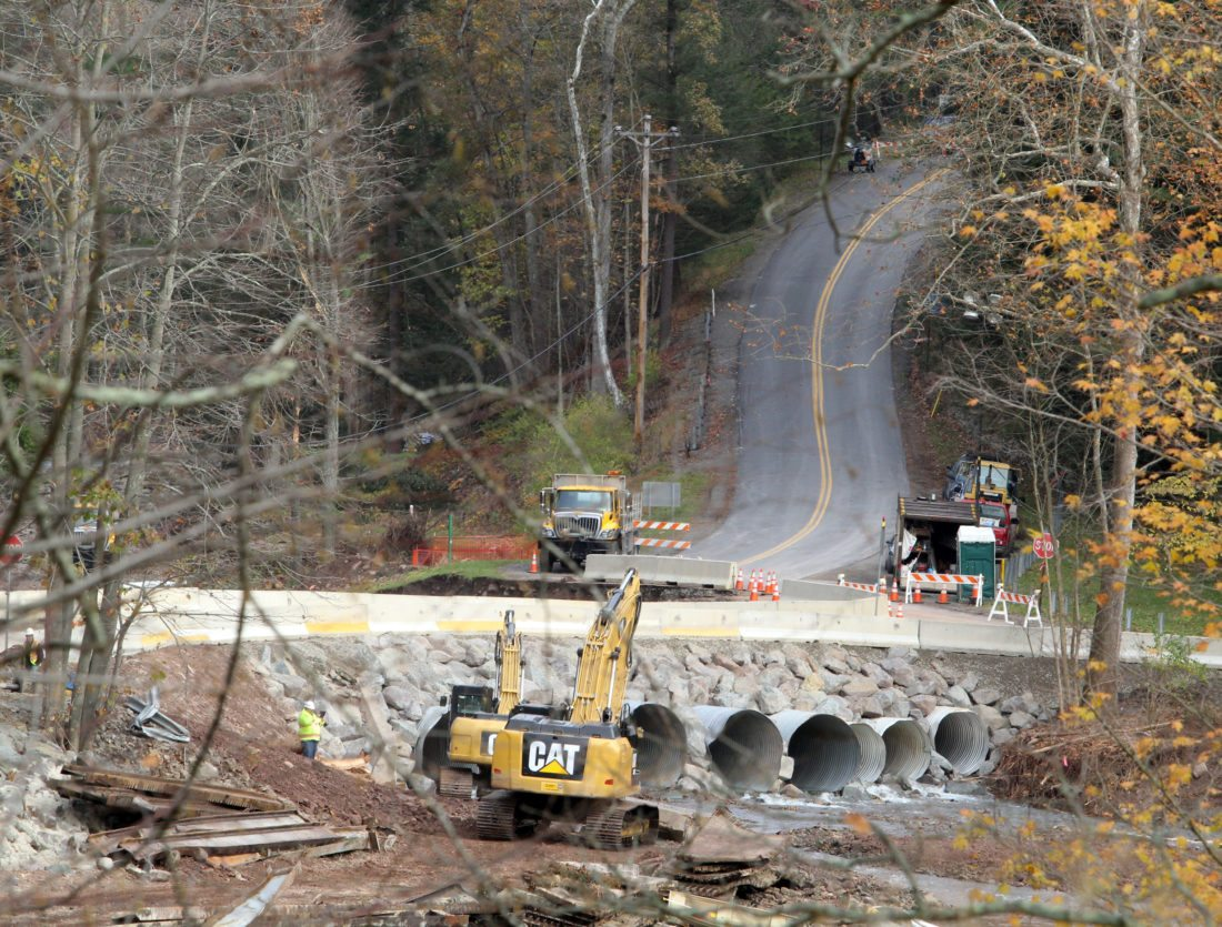 KAREN VIBERT-KENNEDY/Sun-Gazette State Department of Transportation crews work on an emergency bridge across Wallis Run on Tuesday. The bridge over Wallis Run was washed out  on Oct. 21.