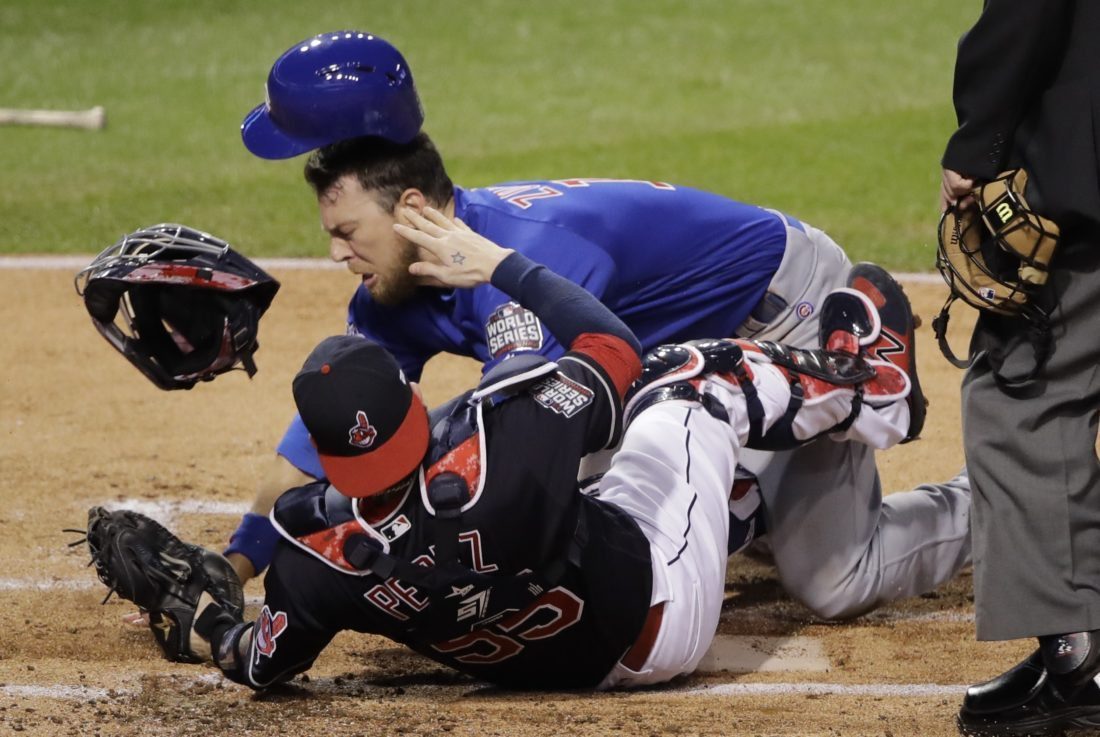 Chicago Cubs' Ben Zobrist collides with Cleveland Indians catcher Roberto Perez as he scores during the first inning of Game 6 of the Major League Baseball World Series Tuesday, Nov. 1, 2016, in Cleveland. (AP Photo/Gene J. Puskar)