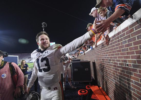Auburn quarterback Sean White celebrates with fans after an NCAA college football game against Mississippi in Oxford, Miss., Saturday, Oct. 29, 2016. No. 15 Auburn won 40-29. (AP Photo/Thomas Graning)