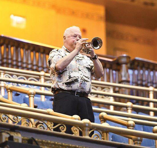 MARK NANCE/Sun-Gazette Vietnam veteran Wayne Peer plays Taps from the balcony during a ceremony honoring U.S. Vietnam War veterans at the Community Arts Center Thursday.