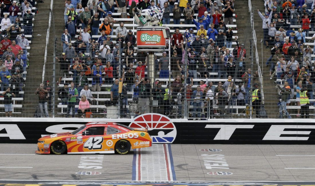 Kyle Larson (42) crosses the finish line winning the NASCAR Xfinity Series auto race at Texas Motor Speedway in Fort Worth, Texas, Saturday, Nov. 5, 2016. (AP Photo/LM Otero)