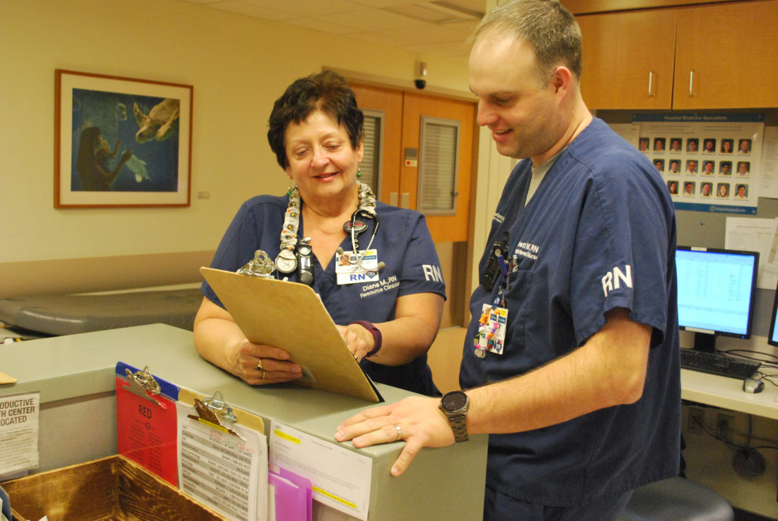 Diane Myers gives report to another nurse in the Emergency Department at Williamsport Regional Medical Center. Myers is retiring from 46 years of nursing.  PHOTO PROVIDED