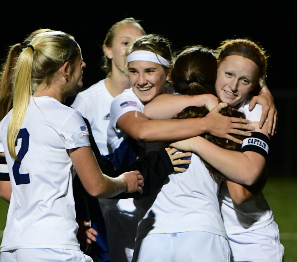Montoursville players celebrate their double-overtime victory over Salisbury Tuesday at Balls Mills.