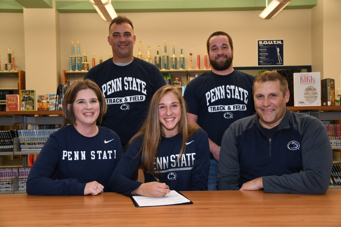 MARK NANCE/Sun-Gazette Katie Jones of South Williamsport, front middle, signed a letter of intent to pole vault for Penn State's Track team next year. From front left is Patti Jones, Katie's mother, Katie, and Mike Jones. her father. Back left is Coach Chris Molino, and pole vaulting coach Ted Deljanovan.