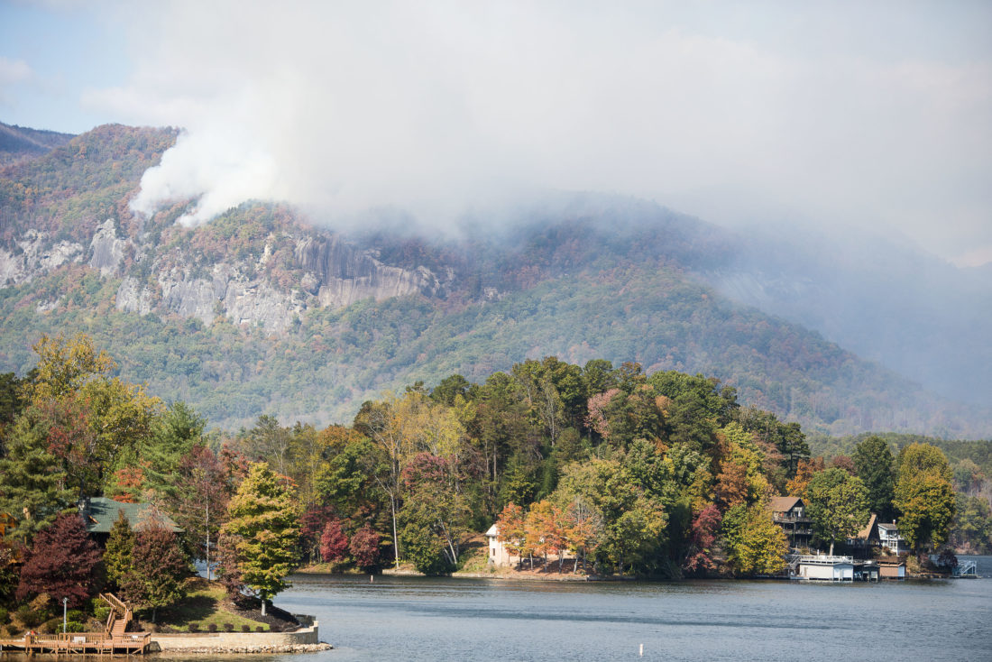 ASSOCIATED PRESS Smoke from the Party Rock fire near Lake Lure spreads as emergency services and the North Carolina Forest Service work to contain the blaze Wednesday at Lake Lure, N.C.