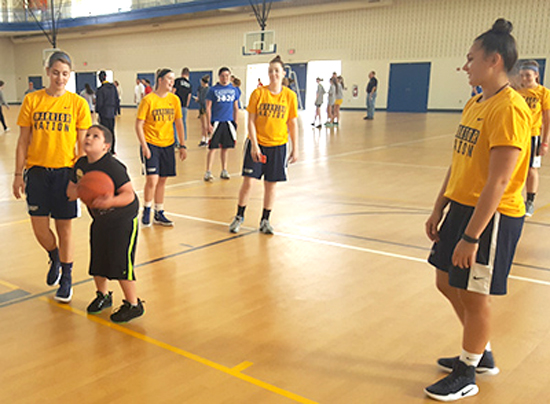 PHOTO PROVIDED The women's basketball team encouraged all participants to play hard during games and cheered on those who spent time practicing free throws.