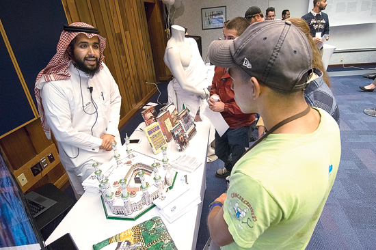 PHOTO PROVIDED Omar A. Aljallal, a plastics and polymer engineering technology major, takes visitors on a journey to the Muslim holy cities of Mecca and Medina.