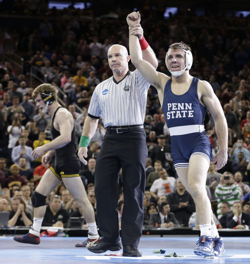Penn State's Zain Retherford, is declared the winner over Iowa's Brandon Sorenson in the 149-pound championship match of the NCAA Division I Wrestling Championships, Saturday, March 19, 2016, in New York. (AP Photo/Julie Jacobson)