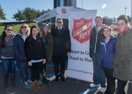 PHOTO PROVIDED At the 5K run/walk held at Williamsport Area High School on Nov. 12, some of the students enrolled in Penn College's Community and Organizational Change course gather with Major Donald Spencer (center), director of the Salvation Army of Williamsport.