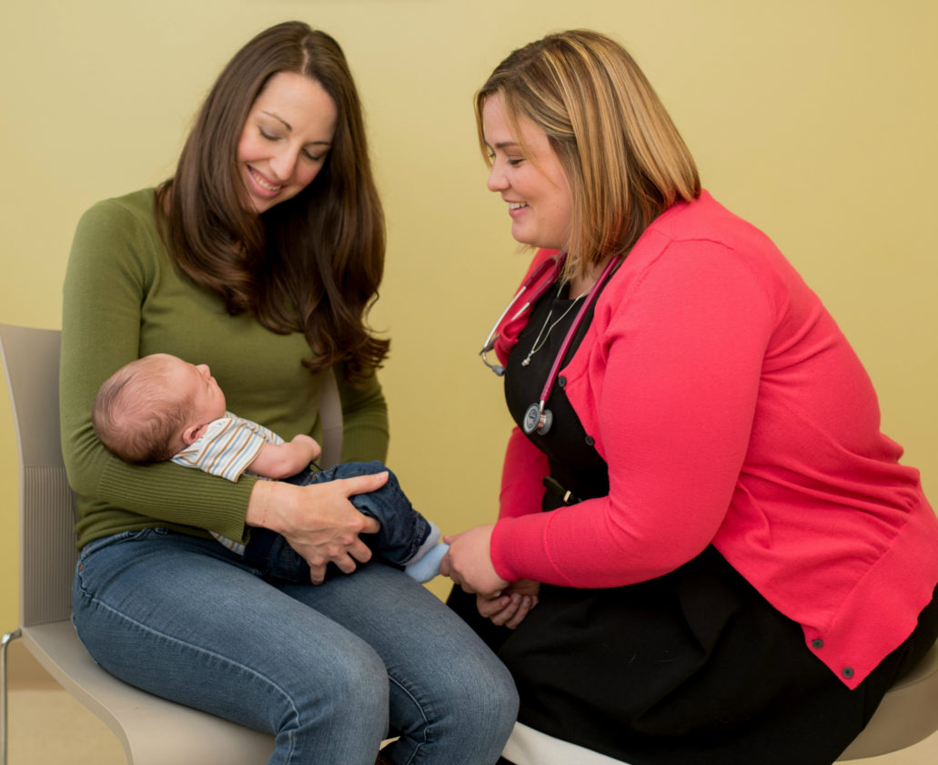 Dr. Ashley Pence, of UPMC Susquehanna, right, interacts with a new mother and her baby. Pence, a pediatrician, offers advice for keeping infants safe as they sleep.               PHOTOPROVIDED