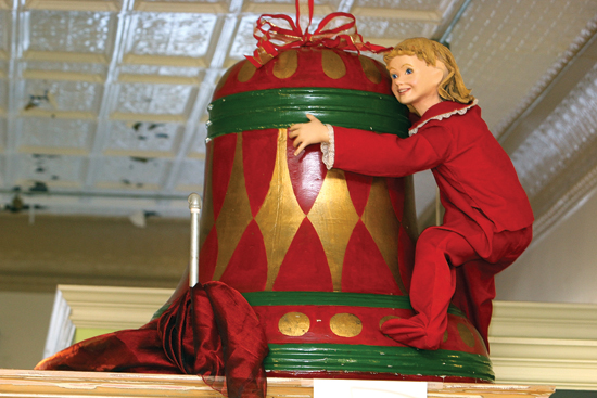 .KAREN VIBERT-KENNEDY/Sun-Gazette The iconic bell that once hung in L.L. Stearns and Sons department store now hangs in Patinaz, 38 W. Fourth St., this holiday season. The bell was donated to River Valley Transit in 1999 by Carole Smith, the former manager of the Lycoming Mall, according to William E. Nichols Jr., of River Valley Transit. The bell was moved to the Trade and Transportation Museum in Williamsport a few years ago. A sleigh that was long a familiar site at the long-closed Stearns can be found in the front window of Patinaz.