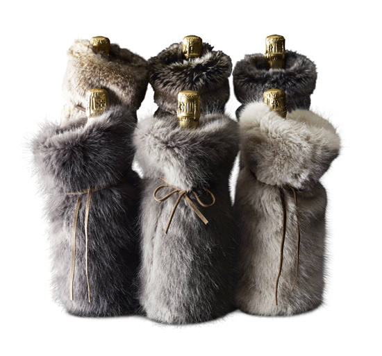 This undated photo provided by Restoration Hardware shows their Luxe faux fur drawstring bags which make glamorous gift holders, as well as dŽcor. (RH via AP)