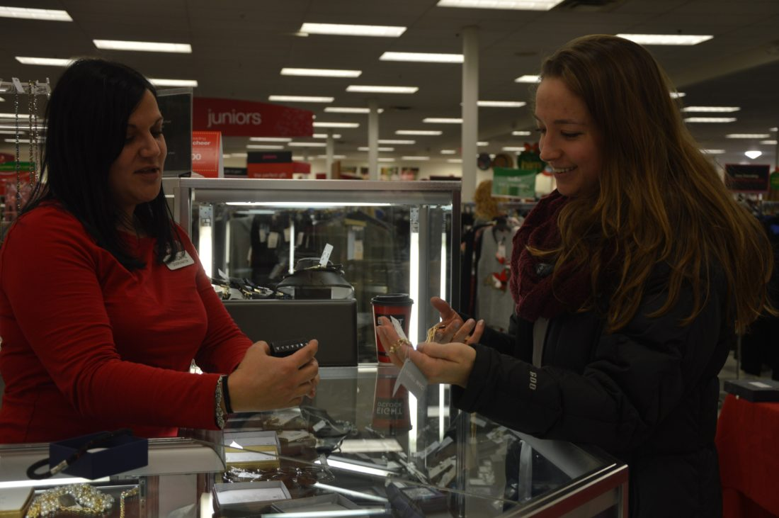 KATELYN HIBBARD/Sun-Gazette A TJ Maxx employee talks jewelry and sales with a customer during Black Friday.