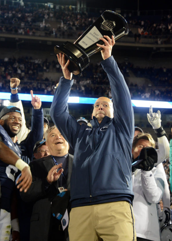 Penn State coach James Franklin holds the Big Ten East Division championship trophy after Saturday's win over Michigan State on Saturday at Beaver Stadium. (PATRICK WAKSMUNSKI/For The Sun-Gazette)