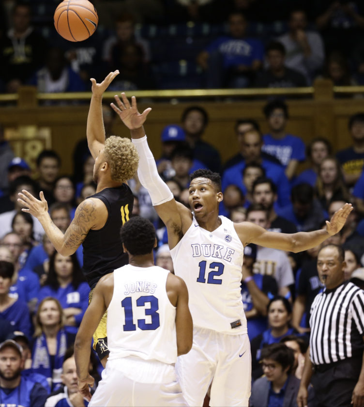Duke's Javin DeLaurier (12) defends as Appalachian State's Emarius Logan shoots during the second half of an NCAA college basketball game in Durham, N.C., Saturday, Nov. 26, 2016. (AP Photo/Gerry Broome)