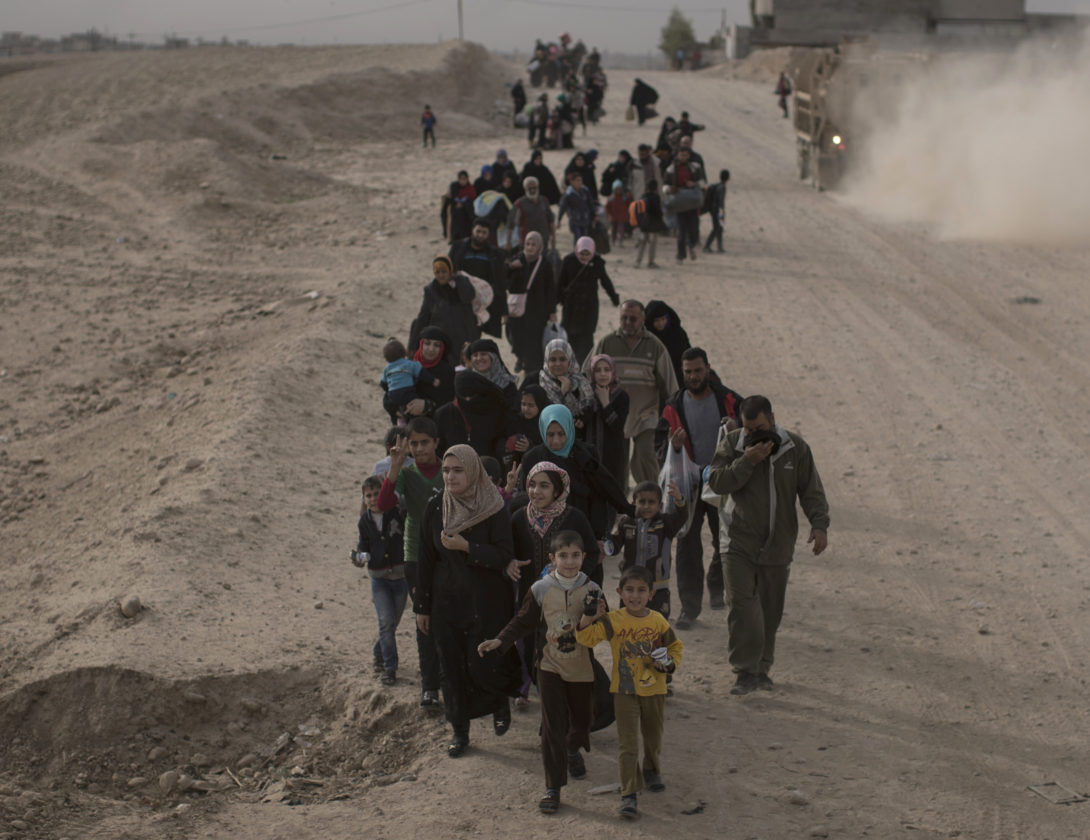 ASSOCIATED PRESS Internally displaced people flee fighting between Iraqi forces and Islamic State militants on a road in eastern Mosul, Iraq, on Nov. 15.