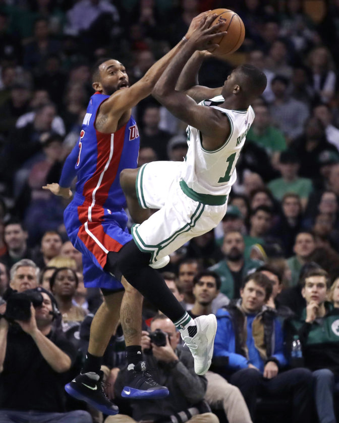 Detroit Pistons guard Darrun Hilliard, left, tries to block a shot by Boston Celtics guard Terry Rozier, right, during the second half of an NBA basketball game in Boston, Wednesday, Nov. 30, 2016. The Pistons defeated the Celtics 121-114. (AP Photo/Charles Krupa)