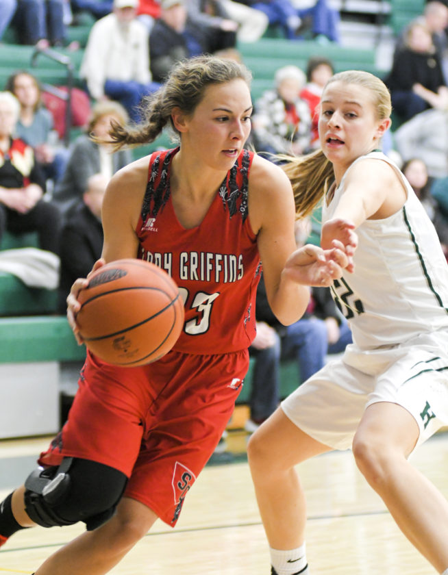 MARK NANCE/Sun-Gazette 23,22 in the fourth Sullivan County's Kaiti Beinlich (23) tries to drive around Hughesville's Jayden Leighow in the fourth quarter.