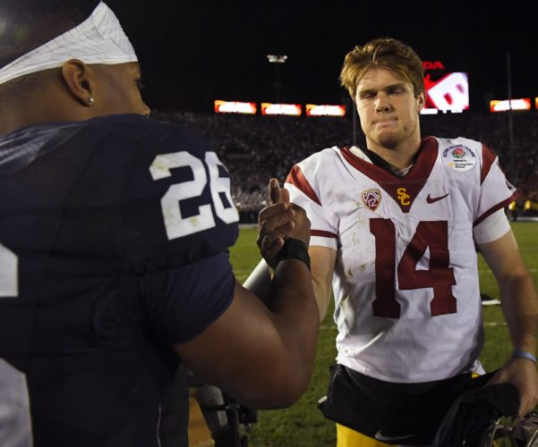 Southern California quarterback Sam Darnold shakes hands with Penn State running back Saquon Barkley after the Rose Bowl NCAA college football game Monday, Jan. 2, 2017, in Pasadena, Calif. (AP Photo/Mark J. Terrill)