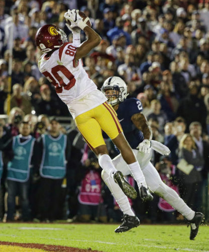 Southern California wide receiver Deontay Burnett catches a touchdown pass in front of Penn State safety Marcus Allen during the second half of the Rose Bowl NCAA college football game Monday, Jan. 2, 2017, in Pasadena, Calif. (AP Photo/Jae C. Hong)