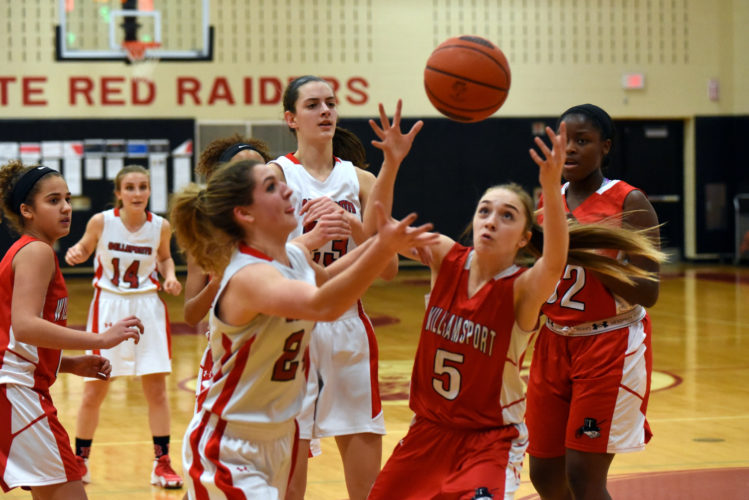 Williamsport's Emily Pardee and Bellefonte's Lauren Young go for a rebound during a girls basketball game at Bellefonte on Wednesday night. (TIMWEIGHT/For TheSun-Gazette)