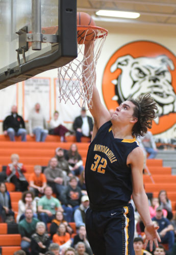 Montoursville's Ethan Buirch dunks the ball on a fast break during the fourth quarter against Jersey Shore on Wednesday evening at Jersey Shore (MARK NANCE/Sun-Gazette)