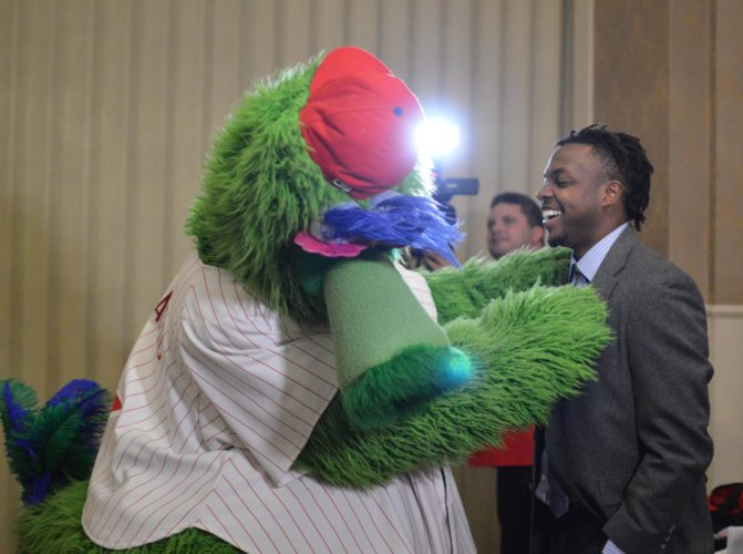 KATELYN HIBBARD/Sun-Gazette Roman Quinn, a former Crosscutter now with the Phillies, jokes with the Philllie Phanatic during the Crosscutters' annual Hot Stove dinner Monday at The Genetti.