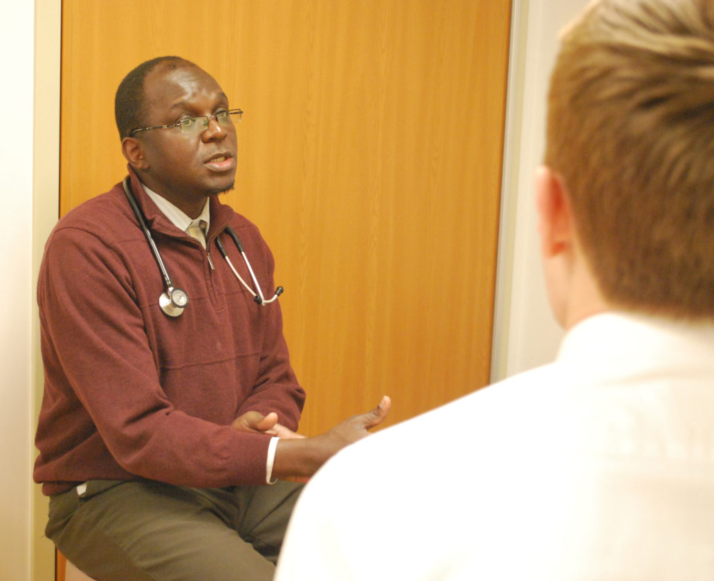 PHOTOPROVIDED Dr. Pius Ochieng, a pulmonary disease specialist in Williamsport, left, consults with a patient. Ochieng says he finds the increase of e-cigarette use among young people alarming.