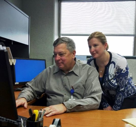 PHOTOPROVIDED Dr. Quentin Novinger, medical director for Highmark Blue Cross Blue Shield, reviews medical information with Crystle Blanco, RN, manager, prior authorization.
