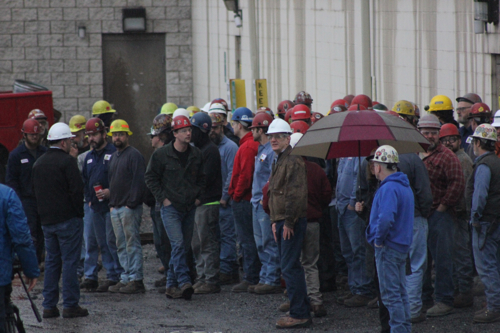 ANNE REINER/Sun-Gazette Employees for High Steel Structures gather to watch as the company prepares the shipment.