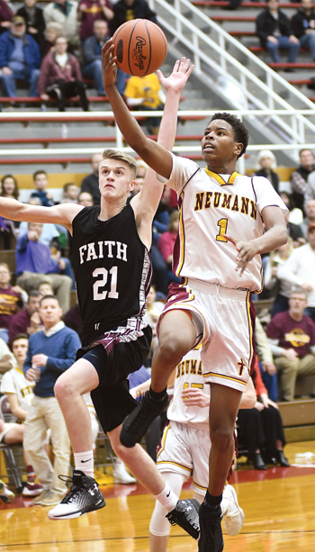 MARKNANCE/Sun-Gazette St. John Neumann's Kevin Anderson drives to the hoop during Saturday's game against Faith Christian at Martz Hall in Pottsville.