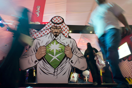 In this photo visitors enter Saudi Comic Con (SCC) which is the first event of its kind to be held in Jiddah, Saudi Arabia. Saudi Arabia. The kingdom, which bans movie theaters and other entertainment venues, is challenging its ultraconservative image and loosening the reins on fun by opening its doors to live shows, including some American ones. (AP Photo, File)