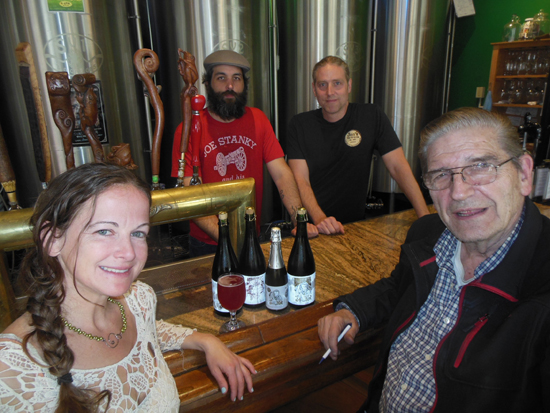 MIKE REUTHER/Sun-Gazette From left, Alicia Koch, Nate Saar, Steve Koch and Bob Koch gather around the bar, with its seven top-25 beers, at Bullfrog Brewery.