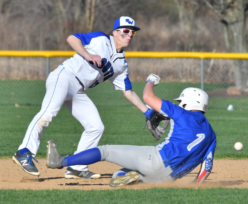 Warrior Run's Kade Meyer is safe at second base as South Williamsport second baseman Lou Winner fields the throw on a steal in the fourth inning on Wednesday. (MARK NANCE/Sun-Gazette)