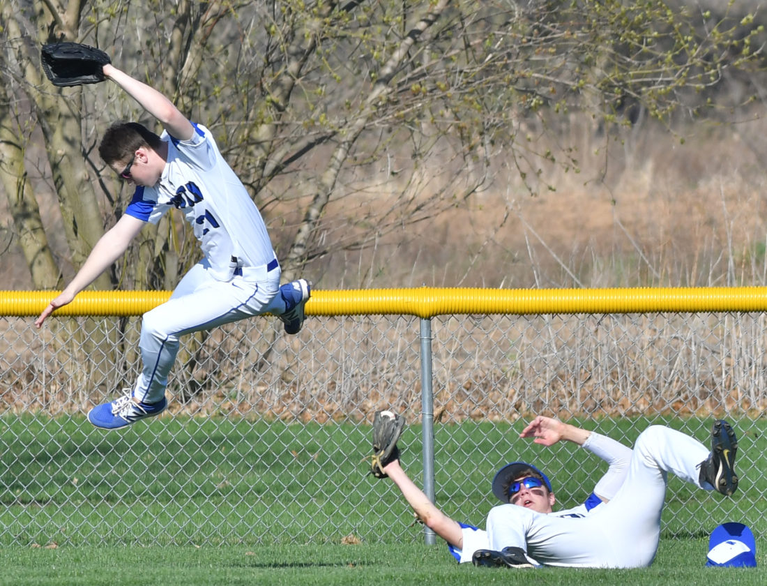 South Williamsport right fielder Tripp Breen leaps over center fielder Aaron Guerrisky after Guerrisky made a diving catch to end the second inning against Warrior Run. (MARK NANCE/Sun-Gazette)