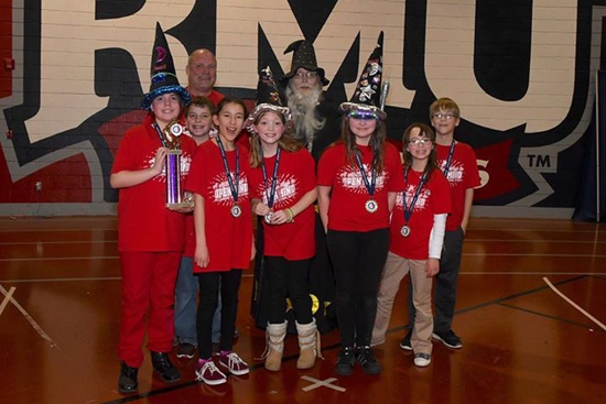 "PHOTO PROVIDED An Odyssey of the Mind team from Curtin Middle School is one of four from the region that is heading to the world competition next month. The team includes, from left in front, Olivia Ciabattari, Tyler Williamson, Muireann Tran, Alanna Ramos, Lilyana Sponhouse, Reese Kirk and Ross Mahler. In back row are coach Bret Southard and Jeremy Owens. Not pictured is coach Denise Southard. The team placed first in Division I, ""A Superhero Cliffhanger."""
