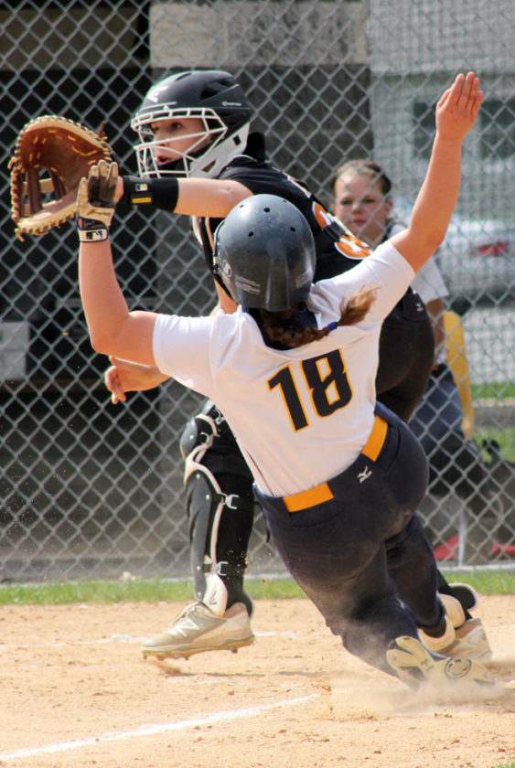 Montoursville's Johna Laubaugh slides home during the Warriors' game against the Jersey Shore Bulldogs on Saturday afternoon. (ANNE REINER/Sun-Gazette)