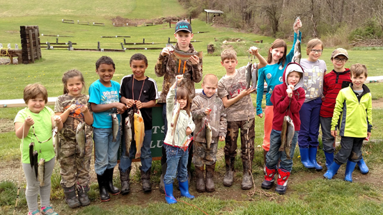 PHOTO PROVIDED Successful anglers line up for a photo with their catches from a previous year's trout derby sponsored by Lambs Creek Sportsman's Club near Mansfield.