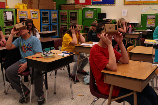 MEGAN BLOOM/Sun-Gazette Correspondent Shown are Lycoming Valley Intermediate School students in Daniel Woleslagle's class using Google cardboard virtual reality goggles in class.